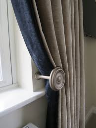 holdback curtains with a contrasting leading edgeover a holdback