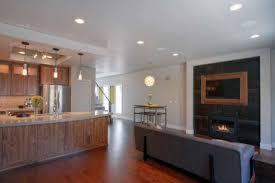 kitchen fireplace flatscreen tv gray paneled wall