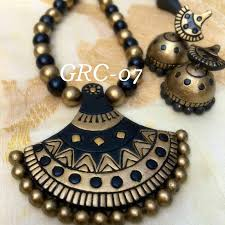 black and golden terracota necklace with jhumkaas