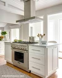 stove island kitchen kitchen remodel reveal mummy kitchens and hanging lights