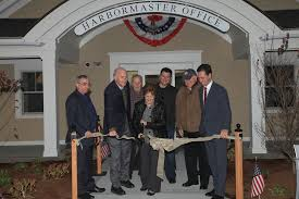 ribbon cutting marks opening of new sandwich marina offices