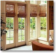 Roman Shade For French Door - sally steponkus interiors mudroom door with glass panes covered