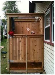 Simple Outdoor Showers - storage to keep towels dry outdoor showers pinterest