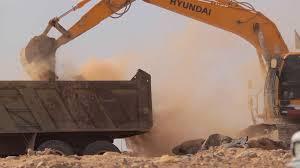 excavator scoop loads a dump truck stock video footage videoblocks