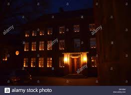 candles in the windows of an german style school building the