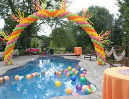 house pool party summer pool party cinco de mayo pink orange yellow balloon arch