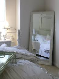 a classic pearl mirror mirror on the wall