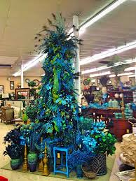 white christmas tree with blue and gold decorations cheminee website