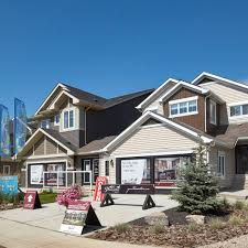 front attached garage homes built by pacesetter in desrochers villages