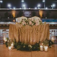 sweetheart table decor comment tablecloth and pillars at base of table sequin