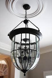 How To Refurbish A Chandelier A Spray Painted Old Brass Light Fixture With Scrapbook Paper Added