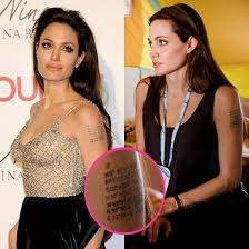 pictures of angelina jolie u0027s arm tattoo with new 7th coordinate