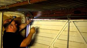 replace spring on garage door how to adjust the spring tension on a garage door in manchester