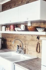 white kitchen with wooden backsplash sans for sånt