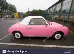 classic nissan pink and white two tone nissan figaro classic cult car stock photo
