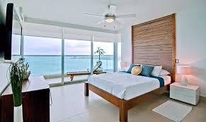 beach style bedrooms white wood master bedroom beach style bedroom toronto by