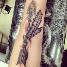 old style indian arrow tattoo done by ayden hinton at