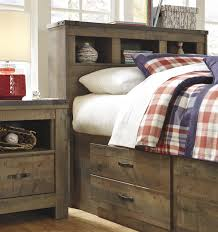 Twin Bed With Storage And Bookcase Headboard by Rustic Look Twin Bookcase Bed With Under Bed Storage By Signature