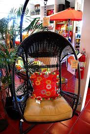 furniture black swingasan chair with red floral and cream