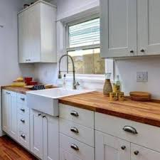 white cabinets with butcher block countertops butcher block countertops with white cabinets and black appliances