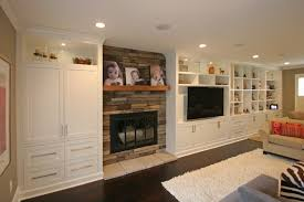 custom built in entertainment fireplace and wall cabinetry