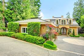 luxury house with beautiful curb appeal view of three car garage