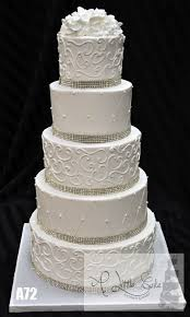 wedding cake icing buttercream iced wedding cake with rhinestone bands wedding