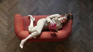 The Red Sofa Seductive Beautiful Young Woman In Glasses And Beige Suit