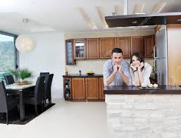 happy young couple have fun in modern kitchen u2014 stock photo