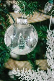 diy snow globe ornament fill a clear ornament with a bottle brush