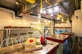 style was used to design this pizza restaurant in new delhi
