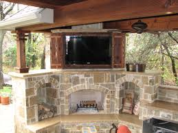 outdoor fireplace with tv home design ideas