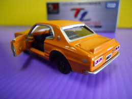 tomica mitsubishi triton tomica limited 50th anniversary skyline 2000 gt r kpgc10
