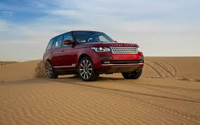 red land rover 2013 land rover range rover in morocco red sand 1 1920x1200