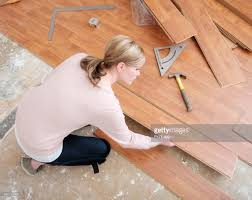 Placing Laminate Flooring Woman Installing Laminate Flooring Stock Photo Getty Images