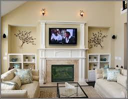 how to layout a living room with tv and fireplace on opposite