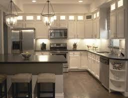 antique white kitchen cabinets with dark island kitchen with