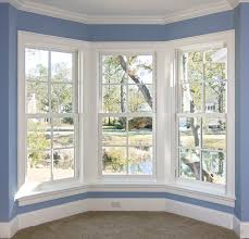 exterior appealing white pella windows with crown molding and