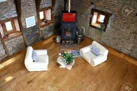 above view of living room with fireplace and cat on rug stock