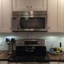 porcelain tile backsplash kitchen miami blue glass backsplash kitchen transitional with beige