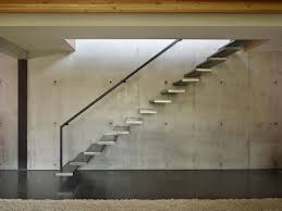 concrete wall stairs exposed concrete wall west seattle residence with