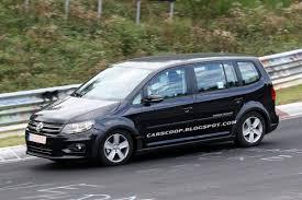vw minivan 2014 spy shots 2014 volkswagen touran mpv test mule wears new model u0027s