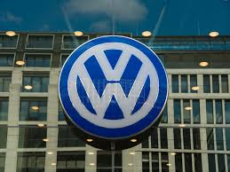 volkswagen group logo general motors company nyse gm tesla motors inc nasdaq tsla