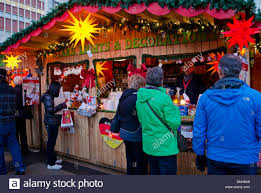shoppers visiting a booth selling german christmas lights and