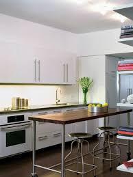 in a compact kitchen a narrow wheeled cart can be a space savvy