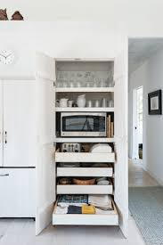 14 strategies for hiding the microwave remodelista shiela narusawa s cape cod kitchen photographed by matthew williams for remodelista