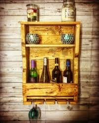 a lovely handmade rustic wine rack with glass holders