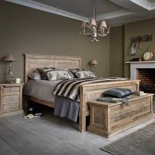 the austen bed frame is made from reclaimed wood with a classic