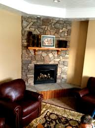 how to decorate a living room with a corner fireplace at home
