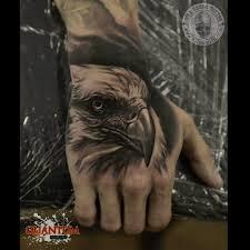 eagle tattoo on finger eagle head hand tattoo tattoo geek ideas for best tattoos